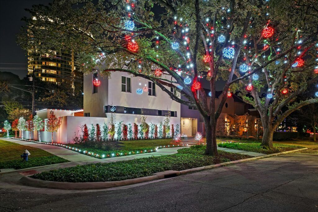 exterior lighting Home christmas lights and tree with red and white lights by The Perfect Light
