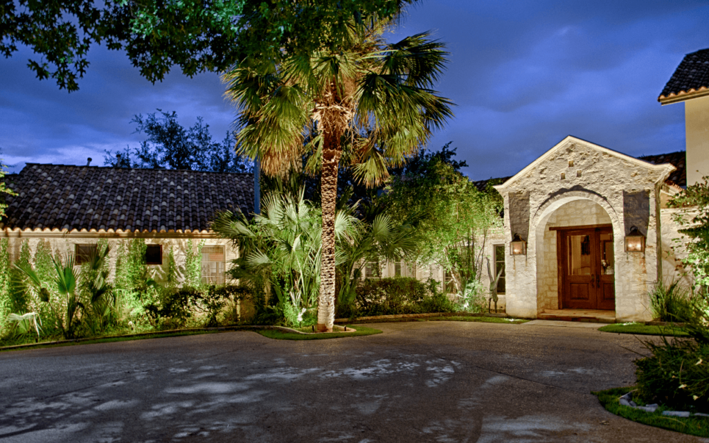 landscape lighting on palm trees and home by The Perfect Light