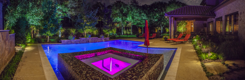backyard patio with pool and landscaping lights by The Perfect Light