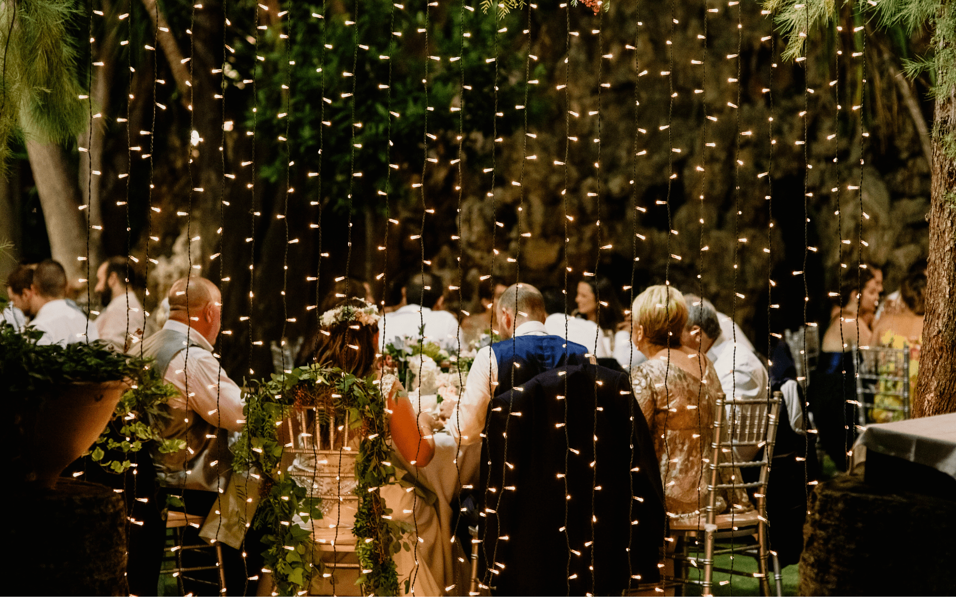 wedding decorated with hanging string exterior lighting
